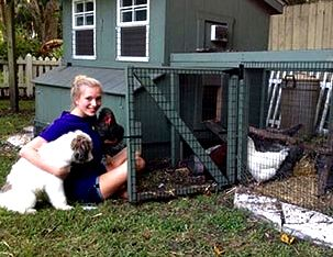 Customer with Chicken and Puppy in Front of Chicken Coop
